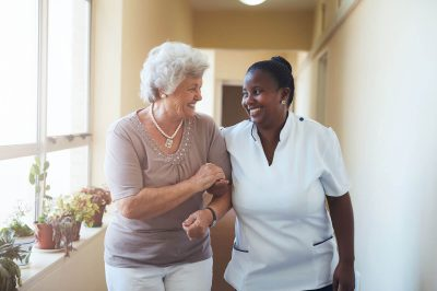 Senior with Nurse in Skilled Nursing Facility